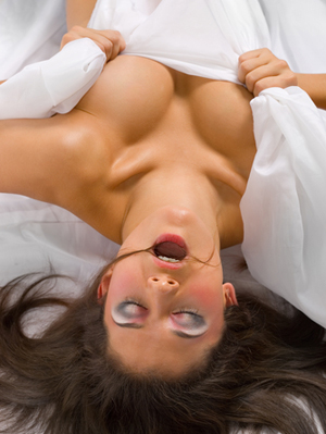 woman-under-sheets-orgasm.jpg